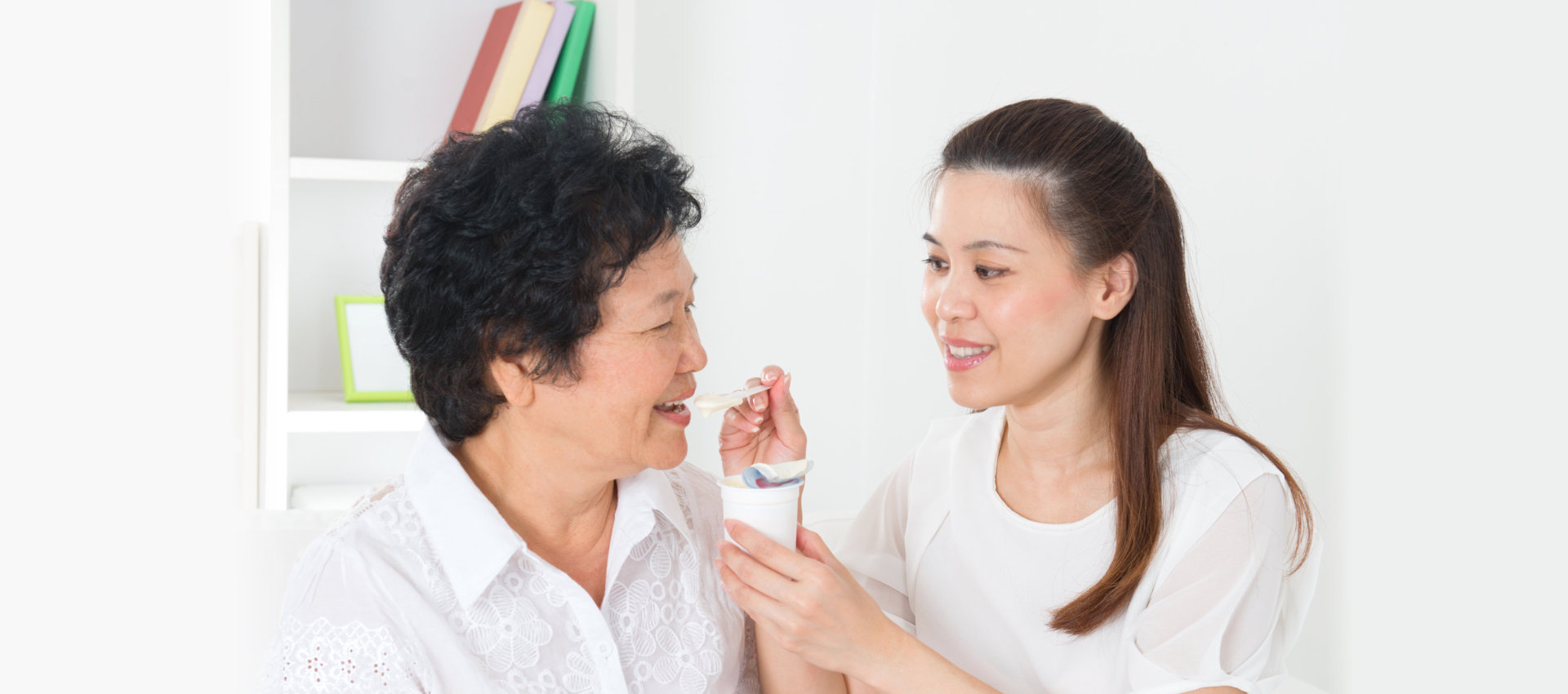 Asian nurse taking care of the elder woman